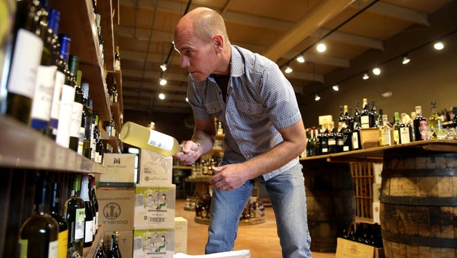 George Koenig and his wife purchased McKnight & Carlson in Appleton and renamed the wine shop Tandem.