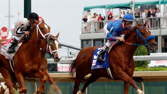 Calvin Borel and Iowa-owned Sugar Shock, right, leads the field during the 2014 Kentucky Oaks at Churchill Downs.