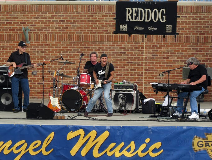 "Members of the band Reddog & Friends perform Sunday evening at the Community Maritime Park as part of the Blues Angel Music's ""Blues on the Bay"" concert series"