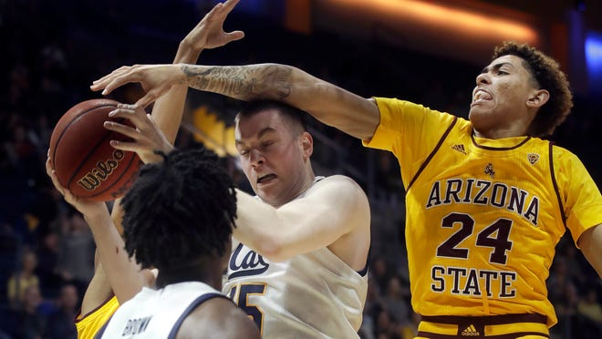 California forward Grant Anticevich, center, is defended by Arizona State forward Jalen Graham (24) during the first half of an NCAA college basketball game in Berkeley, Calif., Sunday, Feb. 16, 2020. (AP Photo/Jeff Chiu)
