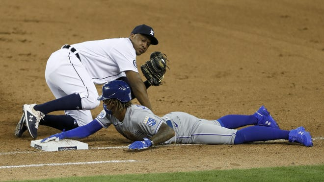 Detroit Tigers second baseman Jonathan Schoop, top, tags out Royals runner Adalberto Mondesi (27) during the ninth inning of Tuesday's game at Comerica Park. The Royals lost 4-3.