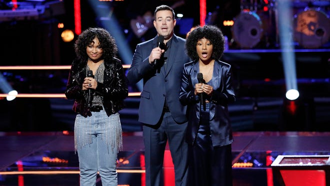 "Newark native Kelsea Johnson (right) learns she has advanced to the next round of ""The Voice""  during Tuesday night's episode. Host Carson Daly and fellow contestant Jordyn Simone look on."