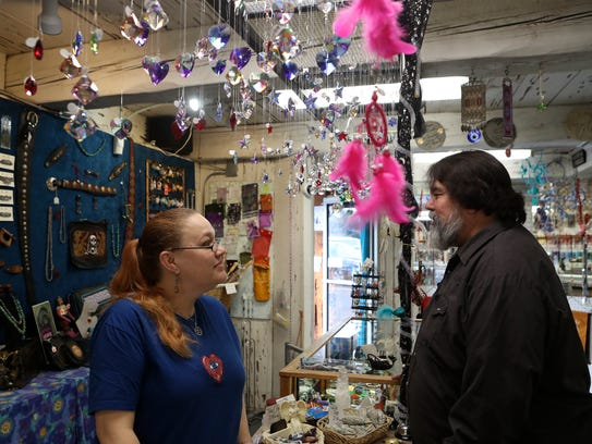 Charlie Neal, right, talks to Beadman store manager