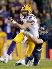 Rice linebacker Blaze Alldredge (55) tries to drag down LSU tight end Foster Moreau (18) in the first half of an NCAA college football game in Baton Rouge, La., Saturday, Nov. 17, 2018. (AP Photo/Gerald Herbert)
