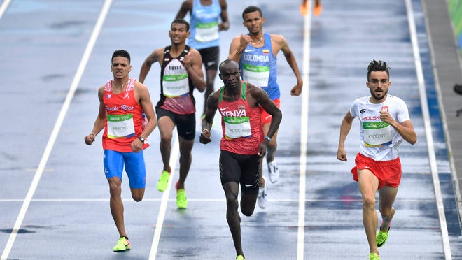 Poland's Adam Kszczot, right, Kenya's Ferguson Rotich, center, and Puerto Rico's Andres Arroyo, left, competes in a men's 800-meter heat during the 2016 Summer Olympics in Rio de Janeiro, Brazil, Friday, Aug. 12, 2016. (AP Photo/Martin Meissner)