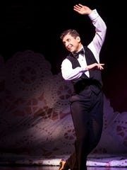 "Tony Yazbeck dazzles in a scene from ""Follies."""