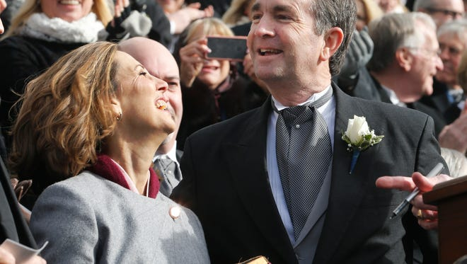 Gov. Ralph Northam, right, and his wife, Pam, smile after he took the oath of office during inaugural ceremonies at the Capitol in Richmond, Va., Saturday, Jan. 13, 2018.