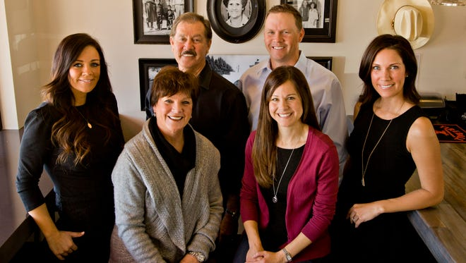 Restaurants are a family business for the Vasquez family — (from left) Amy, Mary, George, Julie, Tim and Jennilyn Costantini. They named Isabel's Amor after late matriarch Isabel Vazquez, seen in the photographs on the wall.