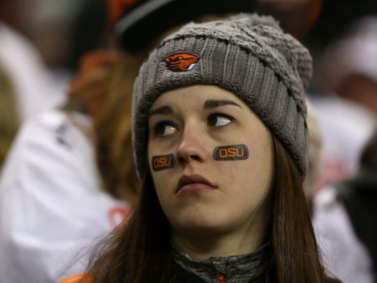 Oregon State fans react to losing their game with Oregon during the Civil War game on Saturday, Nov. 29, 2014, in Corvallis, Ore.