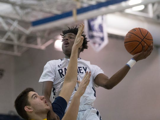 Ranney's Bryan Antoine shots  over the head of Toms River North's Will Marsh during second half action. Ranney School Boys Basketball vs Toms River North in SCT Quarterfinal game in Toms River on February 18, 2018.