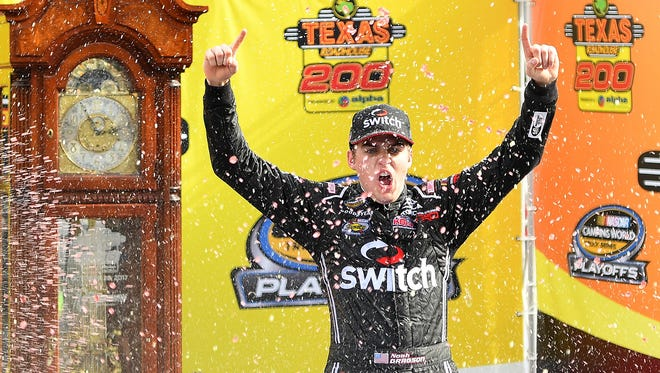 Noah Gragson celebrates after winning Saturday's NASCAR Camping World Truck Series at Martinsville Speedway.