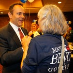 Kentucky Republican gubernatorial candidate Matt Bevin talks with campaign supports at his Election Night headquarters at the Galt House.