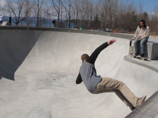 Andrew Bock, a freshman at UVM, rides a near-vertical wall Saturday at the waterfront skatepark in Burlington.