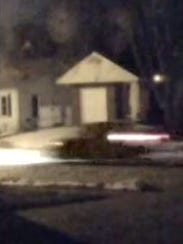 An image captured from survillance video of a car suspected