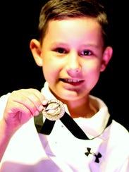 Second grader Rowdy Smrkovsky proudly displays his