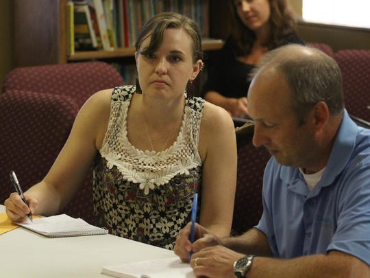 Daily Herald Media reporter Nora Hertel and executive editor Mark Treinen pay attention as about 30 people attended a Daily Herald Media listening session at the Salvation Army on Wausau's west side, Wednesday, July 29, 2015.