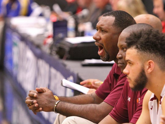 Pensacola head coach Terrance Harris yells plays from the bench as his team battles Largo during the FHSAA 6A semi final Friday February 26, 2016 in Lakeland, Florida. Pensacola lost the match 54-56. Photos by Cindy Skop 2016