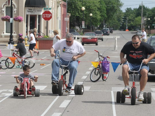 Ben Avitt, 8, Indianola Mayor Kelly Shaw and Greg Avitt race. The Indianola Parks and Recreation Department sponsored the annual Bike Fest on the Indianola Square on June 17.