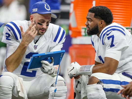 Indianapolis Colts quarterbacks Brian Hoyer (2) and Jacoby Brissett (7) talk on the bench during the third quarter against the New Orleans Saints at Mercedes-Benz Superdome in New Orleans on Monday, Dec. 16, 2019.  Monday Night Football Photos Of Game Against Indianapolis Colts And New Orleans Saints