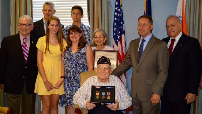 John Politi Sr. was presented three medals and a pin by County Executive Rob Astorino for his  Navy service World War II from 1943 to 1946.