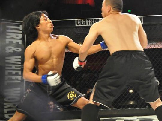 Nathan Napolitano, left, drops Phuc Vasquez during their Central Coast Throwdown fight in October 2014.