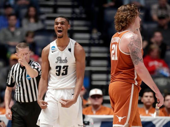 Nevada guard Josh Hall (33) reacts next to Texas forward Dylan Osetkowski (21) in the first half of a first-round game of the NCAA college basketball tournament in Nashville, Tenn., Friday, March 16, 2018. (AP Photo/Mark Humphrey)