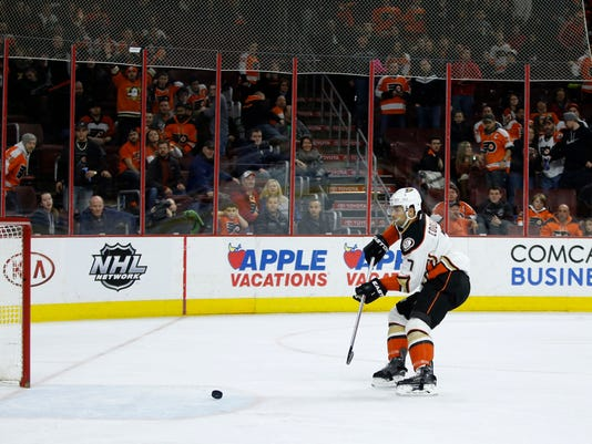 Anaheim Ducks' Andrew Cogliano scores an empty-net goal during the third period of an NHL hockey game against the Philadelphia Flyers, Tuesday, Feb. 9, 2016, in Philadelphia. Anaheim won 4-1. (AP Photo/Matt Slocum)