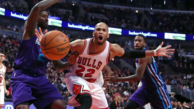 Chicago Bulls forward Taj Gibson reacts to being fouled by Charlotte Hornets forward Marvin Williams during the second half.