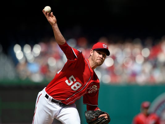 Washington Nationals starting pitcher Doug Fister delivers a pitch against the Atlanta Braves during the first inning of a baseball game, Saturday, May 9, 2015, in Washington. (AP Photo/Nick Wass)