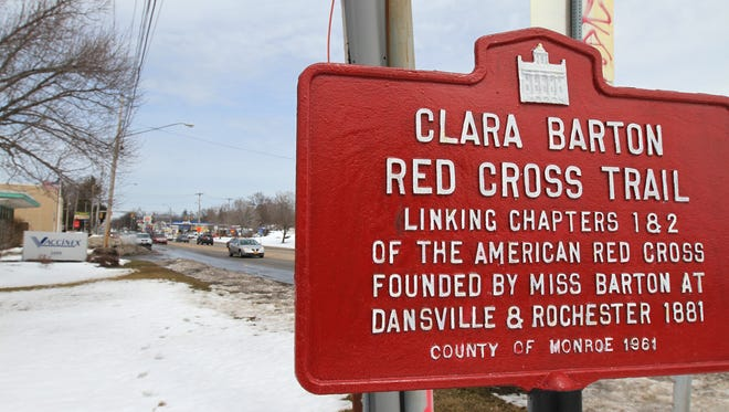 A sign linking Chapters 1 and 2 on the Clara Barton Red Cross Trail is posted on Mt. Hope Avenue.