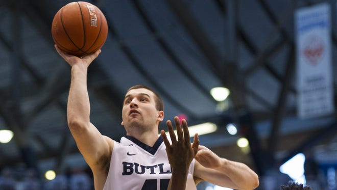 Butler Bulldogs forward Andrew Chrabascz (45) puts up a shot during the first half of a NCAA men's basketball game at Butler University's Hinkle Fieldhouse, Saturday, Feb. 13, 2016.