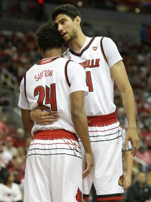 Louisville's Anas Mahmoud, right, has a word with teammate Dwayne Sutton after Sutton was missed a layup. Dec. 3, 2017.