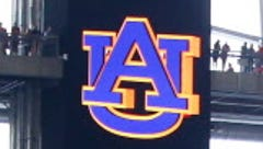 Auburn softball coach had been banned from campus by school