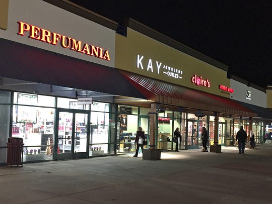 Shoppers stroll between stores at the Albretville Outlet