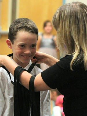 Students are awarded with medals during the Literacy Showcase. This year's showcase will be held on Friday, March 31, at the mimbres Valley Special Events Center, 2300 E. Pine St.