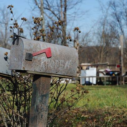 A mailbox, a porch where a trailer stood and miscellaneous