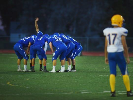 Garretson huddles during the game.
