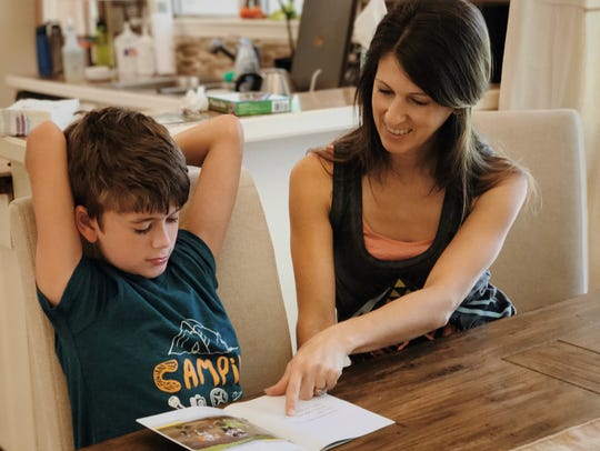 Jett Mullins, a home-schooled second-grader, is learning