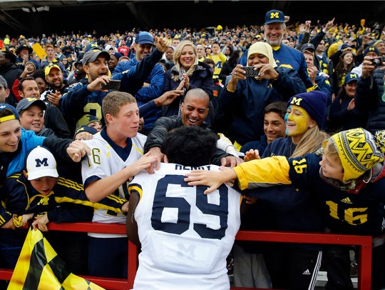 Fans celebrate with Michigan defensive tackle Willie