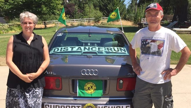 """Hervé Leconte, right, plans to start a 500-mile run to raise awareness and legal funds for the State of Jefferson. His wife, Julie, left, will accompany him in her """"support vehicle."""""""