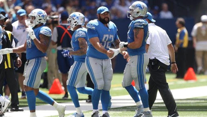 Lions defensive lineman Haloti Ngata greets players coming off the field during the second quarter of the Lions' 24-10 exhibition win over the Colts on Sunday, Aug. 13, 2017, in Indianapolis.