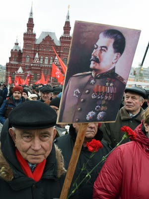 Russian Communist Party supporters with photos of Joseph Stalin in Moscow on March 5, 2017.