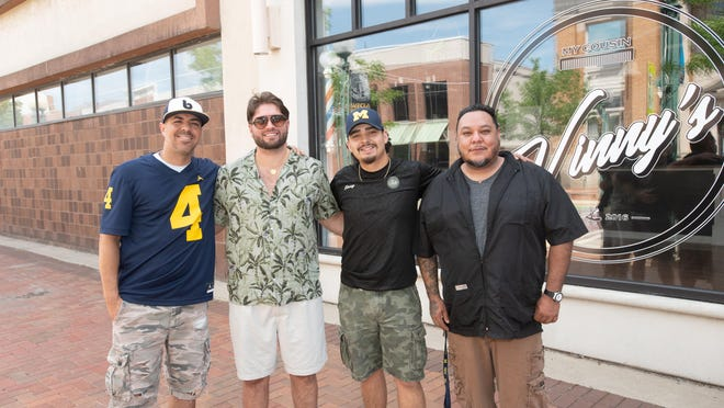 Joe Villalobos, Austen Gray, Vinny Inclan and Michael Mota of My Cousin Vinny's Barbershop in downtown Adrian prepare to reopen on Monday, June 15.