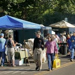 Customers walk through the Farmers Market in downtown Great Falls during the summer.