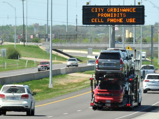A Texas Department of Transportation sign on U.S 82 East warns the motoring public of a new city law prohibiting drivers from using handheld cellphones and devices while driving in the city limits.