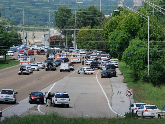 Police and emergency vehicles block Amnicola Highway after a morning shooting near the Naval Reserve Center, in Chattanooga, Tenn., on July 16, 2015.
