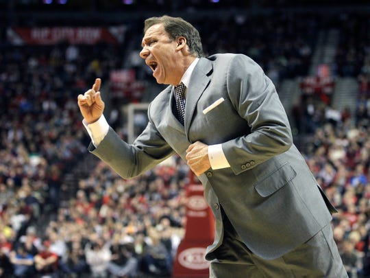 In this March 22, 2011, file photo, Washington Wizards head coach Flip Saunders shouts at an official in the second quarter of an NBA basketball game against the Portland Trail Blazers in Portland, Ore. Saunders, the longtime NBA coach who won more than 650 games in nearly two decades and was trying to rebuild the Minnesota Timberwolves as team president, coach and part owner, died Sunday, Oct. 25, 2015, the team said. He was 60.