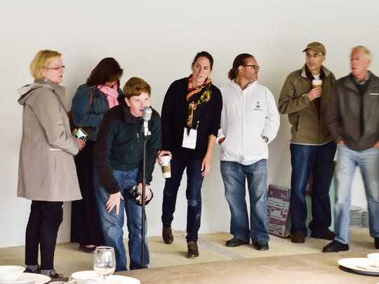 """Indianapolis artist Emily Kennerk (center) instructs ArtPrize attendees on how to interact with her installation """"Whispers."""""""