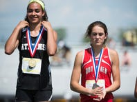 """Annville-Cleona's Reagan Hess (right) applauds for Athens Breana Gambrell after she received her gold medal in the girls AA long jump during day one  of the PIAA state track and field championships  on Friday, May 27, 2016. Hess jumped a 19' 1"""" to claim silver and break a PR"""