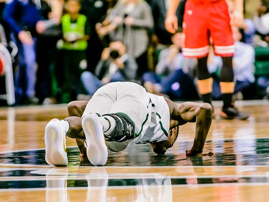 Senior Eron Harris of MSU kisses the Spartan at mid-court after checking into the Spartans' game with Wisconsin Sunday February 26, 2017 in East Lansing.  The last second substitution allowed the injured guard to enter the game and kiss the Spartan at mid-court as he fellow seniors did.  KEVIN W. FOWLER PHOTO